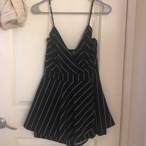 Black with white stripes romper